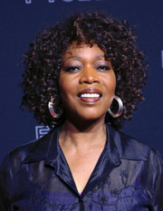 Alfre Woodard attended the Netflix FYSEE kickoff event wearing her hair in tight curls.