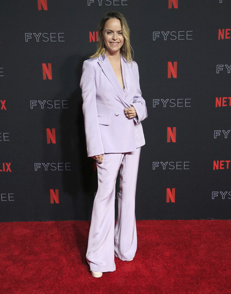 Taryn Manning attended the Netflix FYSEE kickoff event wearing a lavender bell-bottom pantsuit.