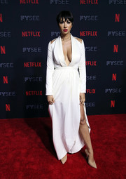 Jackie Cruz oozed sex appeal wearing this white gown with a plunging neckline, shoulder cutouts, and a high side slit at the Netflix FYSEE kickoff event.