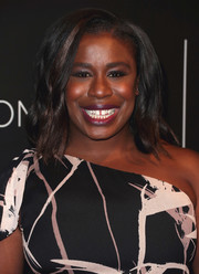 Uzo Aduba wore her hair down to her shoulders in a subtly wavy style during the Netflix FYSEE kickoff event.