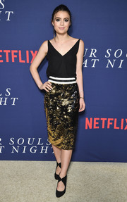 Sami Gayle finished off her look with black cutout pumps.