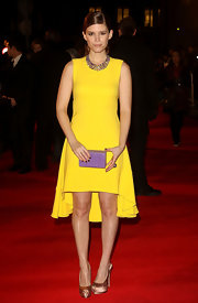 Kate Mara's lavender Nancy Gonzalez crocodile box clutch popped against her sunny yellow dress.