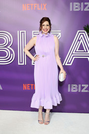 Vanessa Bayer rounded out her look with a white hard-case clutch.