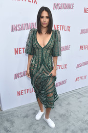 Chloe Bridges flashed some skin in a sheer green midi dress by Leilou at the premiere of 'Insatiable' season 1.