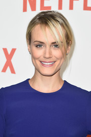 Taylor Schilling attended the Netflix launch party in Paris rocking a messy updo.