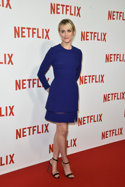 Taylor Schilling was all about understated sophistication in a long-sleeve cobalt cocktail dress by Elie Saab at the Netflix launch party in Paris.