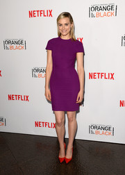 Taylor Schilling oozed feminine appeal in a figure-hugging purple sheath by Roland Mouret during the 'Orange is the New Black' panel discussion.