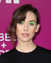 Alison Brie was impossible to miss with her neon-green eyeshadow!
