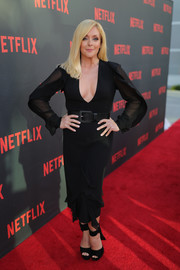 Jane Krakowski complemented her dress with black ankle-wrap platform sandals.