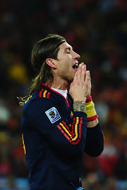 Spanish footballer Sergio Ramos keeps his long hair away from his face with a simple black headband.