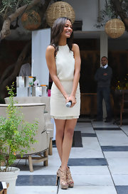 Zoe Saldana looked ultra chic in a cream cocktail frock topped off with nude python strappy sandals.
