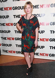 Julia Stiles teamed her paint splattered print dress with black cut out booties.