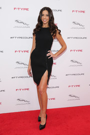 Terri Seymour chose a little black dress with zipper detail and a thigh-baring slit for the Jaguar F-Type coupe debut.