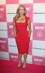 Brooke Kinsella showed off her figure in a red dress with square neckline and pockets.