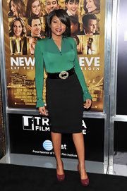 Taraji P. Henson was secretary chic at the New York premiere of 'New Year's Eve' in a sleek black pencil skirt with waist-cinching belt.