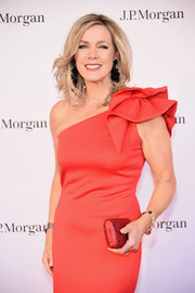 Deborah Norville paired a beaded red clutch with a one-shoulder dress for the New York City Ballet 2018 Spring Gala.
