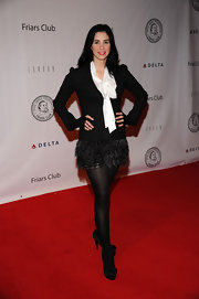 Sarah Silverman looked demure in satin platform pumps. The bow-adorned pee toes looked adorable paired with her feather skirt and tie neck blouse.