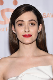Emmy Rossum swiped on some matte red lipstick for a dazzling pop to her look.