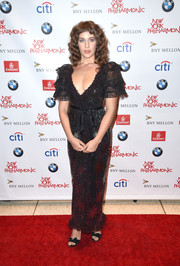 Lola Kirke went flirty in a low-cut black sequin gown with ruffle sleeves during the New York Philharmonic's opening gala.