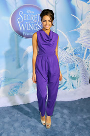 Olivia Culpo looked playful in this bright purple cowl-neck jumpsuit at the 'Secret of the Wings' premiere.
