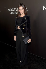 Julia Restoin-Roitfeld teamed black wide-leg pants with a velvet jacket and a crop-top for the New York premiere of 'Nocturnal Animals.'