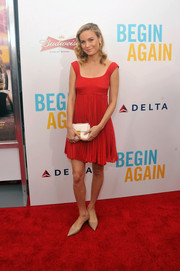 Brie Larson chose a red empire-waist cocktail dress by Prada for the premiere of 'Begin Again.'