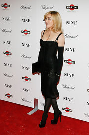 Madonna wore bicep-high gloves with her corset dress for the premiere of 'Nine' in NYC.