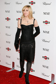 Madonna wore a provocative corset dress for the 'Nine' screening in NYC.