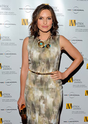 Actress Mariska paired her abstract print dress with a bronzed and turquoise statement necklace, which was a great way to make her dress stand out.