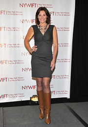 LuAnn elongated her awards ensemble with a pair of chic tan boots.