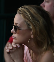 Thin gold hoops are perfect for daytime and look great with Kate's gold aviators.