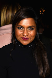 Mindy Kaling wore a loose side-swept ponytail at the 2014 New Yorker Festival wrap party.