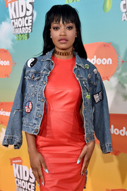 Keke Palmer arrived for the Nickelodeon Kids' Choice Awards wearing a patched-up denim jacket over a bright leather dress.