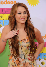 Miley Cyrus paired a classic red polish with her colorful floral gown at Nickelodeon's 24th Annual Kids' Choice Awards.
