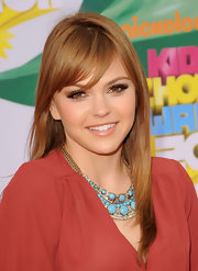 Aimee Teegarden accented her neckline with a turqouise necklace.