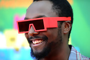 Will.i.am rocked neon pink shades in a cool robotic style at the 2011 Kids' Choice Awards.