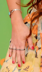 Miley Cyrus made a statement on the orange carpet in a full finger diamond ring.