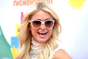 Paris Hilton was all smiles at the 2011 Kids' Choice Awards wearing Diorific sunglasses in white with gold trim.