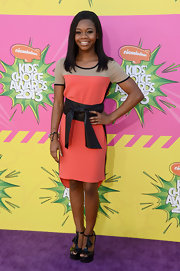 Gabby Douglas traded in her sport leotard for a totally feminine cocktail dress with a thick black belt.