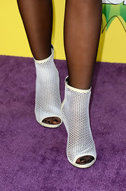 Kylie Jenner sported these cage-style ankle booties with a peep toe for her red carpet look at the KCAs.