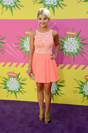 Stefanie Scott looked fun and flirty in this pink dress with an embroidered top and full, pleated skirt.