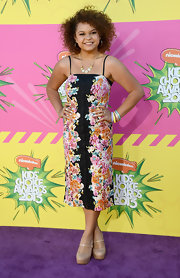 Rachel Crow showed off her playful side with this floral column-style dress with front button detailing.