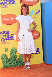 For her shoes, Sarah Hyland chose white Casadei sandals with broad crisscross ankle straps.