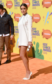 Olivia Culpo made a super-chic appearance at the Kids' Choice Awards in a leg-flaunting, high-neck LWD by Saint Laurent.
