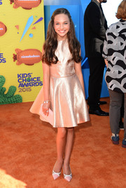 A pink leather clutch by Tory Burch rounded out Maddie Ziegler's ensemble.
