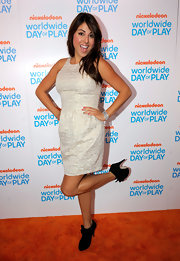 Daniella Monet attended Nickelodeon's 8th Annual Worldwide Day of Play wearing a gray dress and a pair of suede ankle boots.