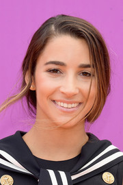 Aly Raisman styled her hair into a loose braid for the 2017 Nickelodeon Kids' Choice Sports Awards.