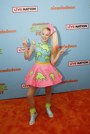JoJo Siwa coordinated her pastel dress with blue canvas sneakers.