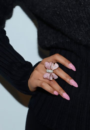 Nicki Minaj tempered her sharp talon-like nails with a soft, girlie shade.
