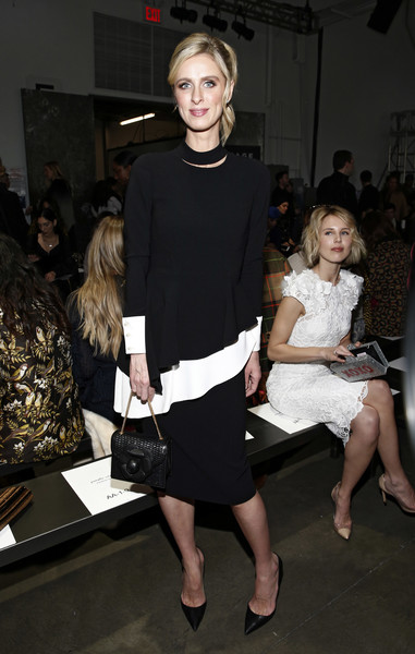Nicky Hilton Leather Purse [fashion,clothing,fashion design,dress,hairstyle,little black dress,shoulder,event,haute couture,fashion model,pamella roland,nicky hilton,front row,new york city,pier 59,new york fashion week,fashion show]